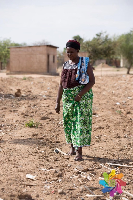 Maize farmer Regina Mwashilemo surveys her dry land. Photo by Hannah Smith Walker